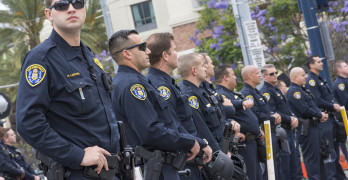 SAN DIEGO USA - MAY 27 2016: San Diego police officers stand on watch in an effort to keep the peace at an anti-Trump demonstration outside a Trump rally at the San Diego Convention Center.