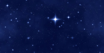 a nice blue star field of bright and shining stars and one bright christmas star
