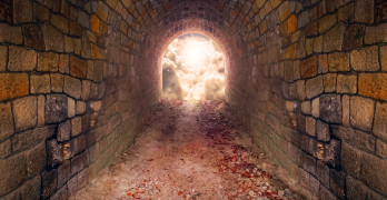 Light at end of the tunnel. Way to freedom or to heaven. Opened door from underground or grave. Hope metaphor.
