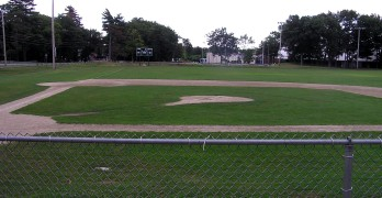 Empty Little League baseball field after the last game of the season